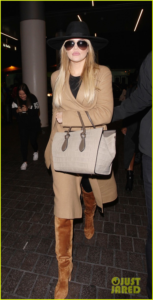 Khloe Kardashian bundles up for her flight out of LAX **USA ONLY**