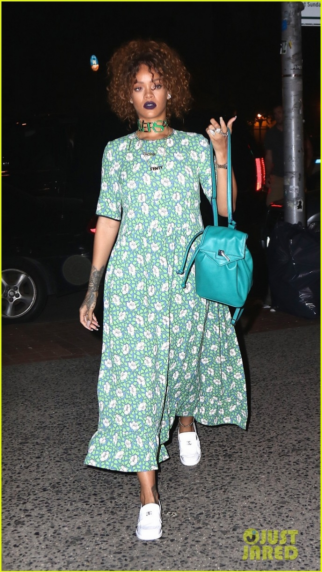 Rihanna steps out this evening in green floral dress, Versace choker, and white Chanel loafers to stop in for body piercings