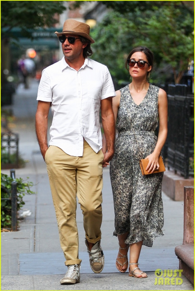 Rose Byrne and Bobby Cannavale walk hand in hand in the East Village