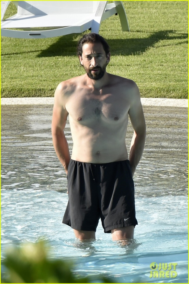 *EXCLUSIVE* Adrien Brody and girlfriend Lara Lieto have a romantic time at the pool **USA ONLY**