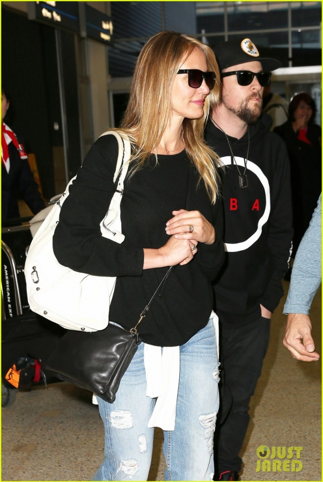 Cameron Diaz and Benji Madden are still in wedded bliss upon arrival in Sydney **USA ONLY**
