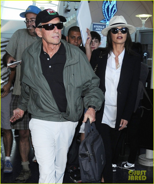 Michael Douglas & Catherine Zeta-Jones Touch Down At LAX