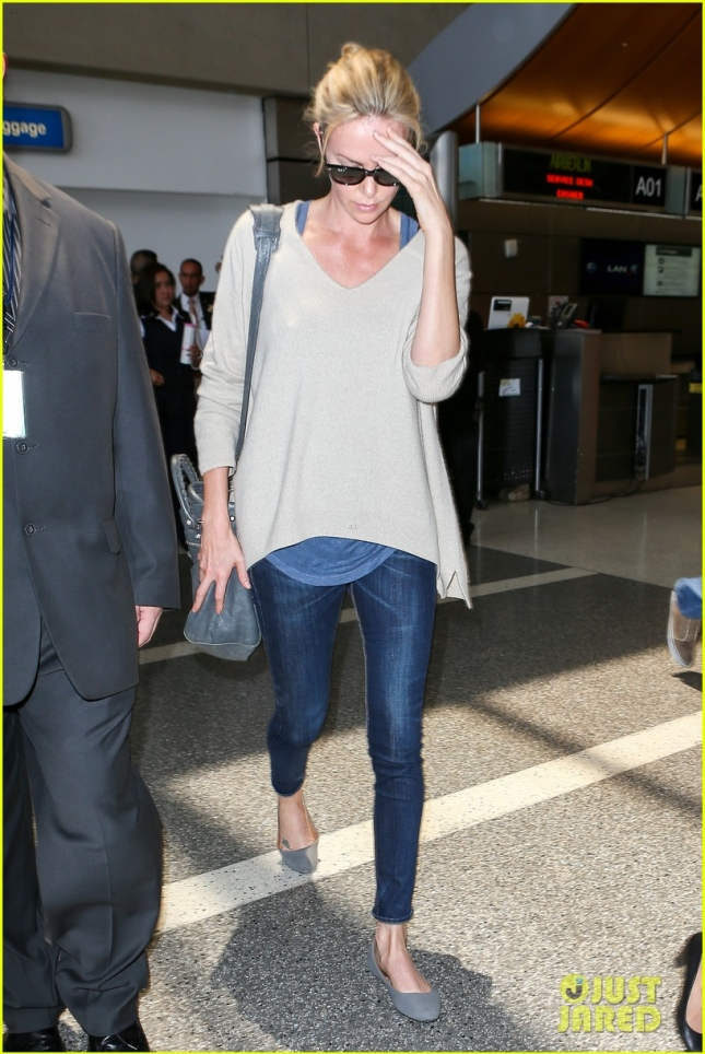 Charlize Theron touches down at LAX **USA ONLY**