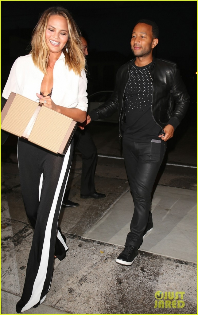 Chrissy Teigen and John Legend are beaming as they head to a dinner party