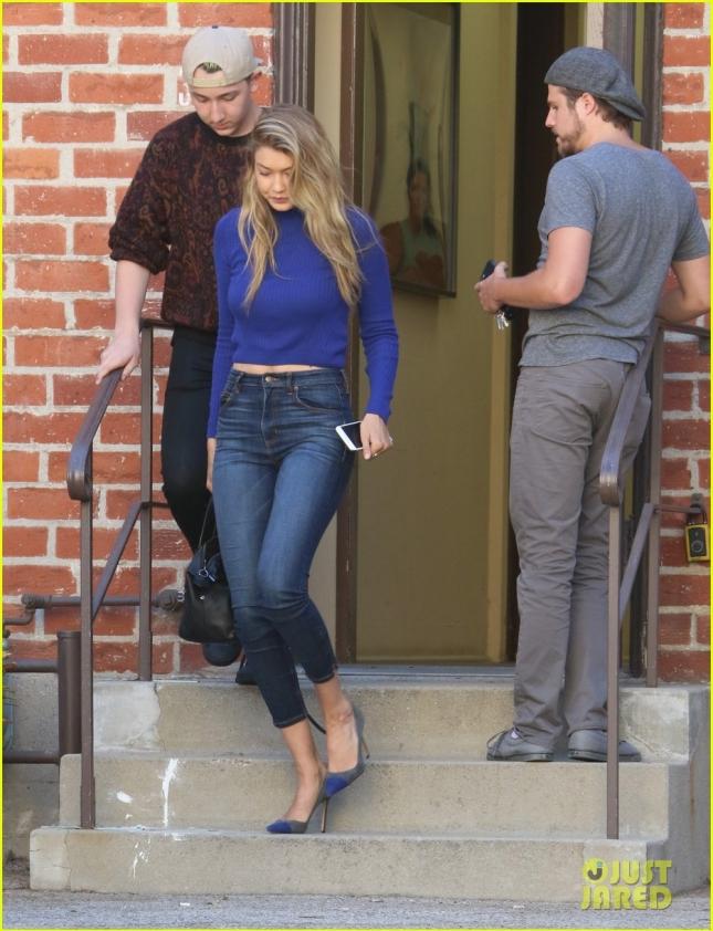 Gigi, in heels this time visits Joe at the studio