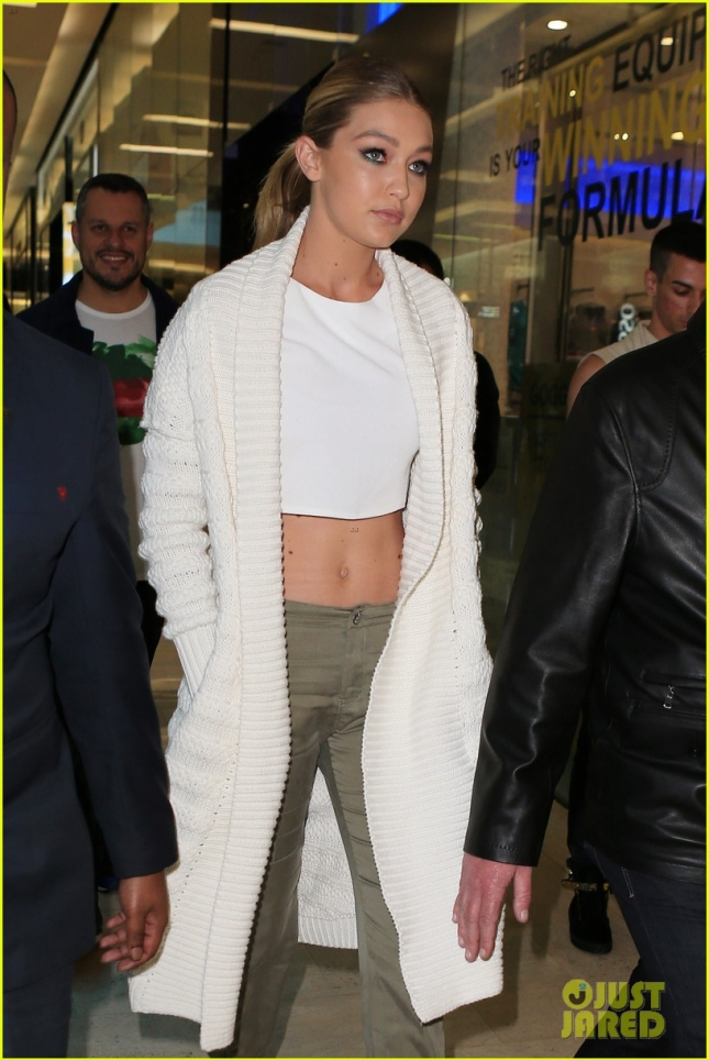 Gigi Hadid shows off her toned tummy at a Guess store appearance in Sydney **USA ONLY**