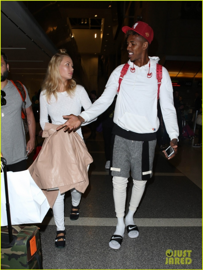 Iggy Azalea and fiancé Nick Young head thru LAX bound for Australia **NO UK**