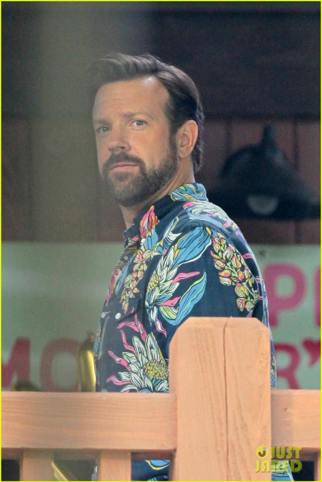 Lucy Walsh looks on as Jason Sudeikis sings in front of a crowd of women before falling off a balcony in scenes for movie 'Mother's Day'