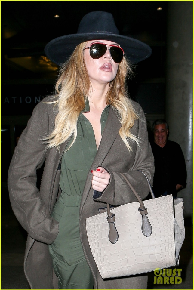 Khloé Kardashian dressed like a spy at LAX Airport - Part 2 **USA ONLY**