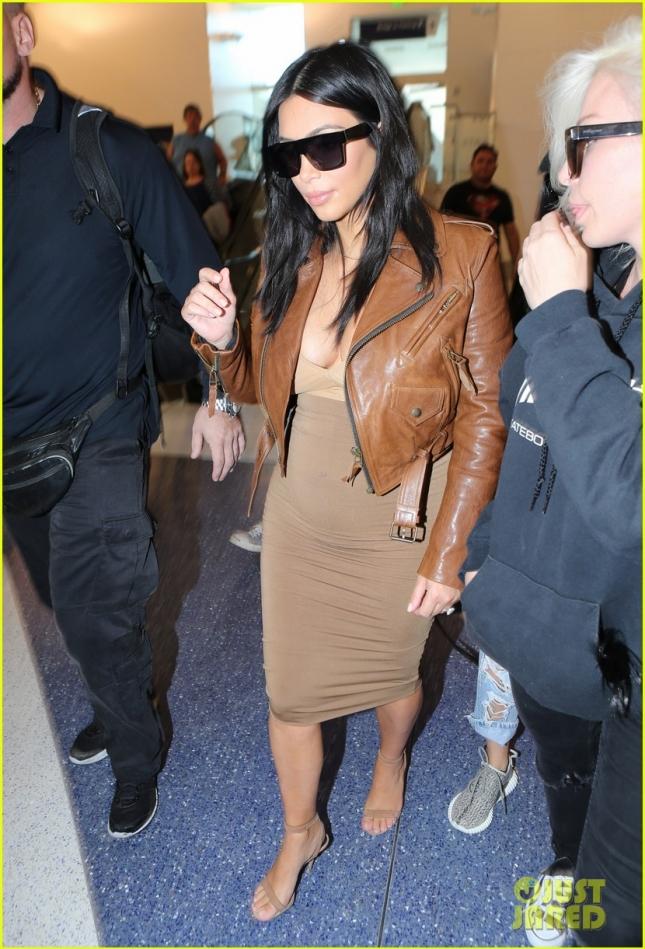 Pregnant Kim Kardashian Catches A Flight At LAX