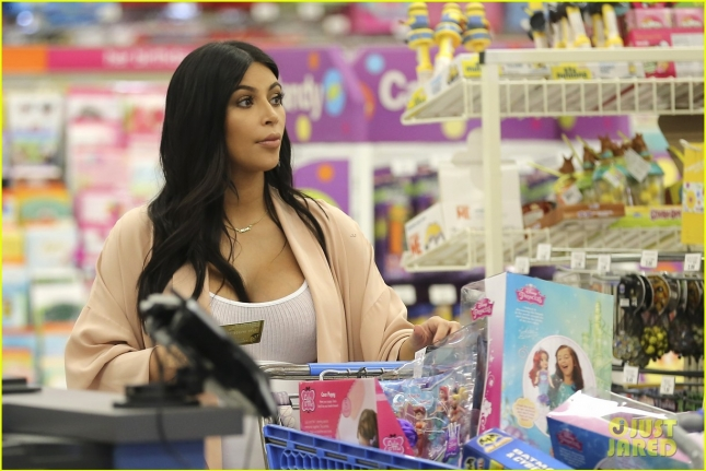 Kim Kardashian waits patiently in line as she goes toy shopping with Mason