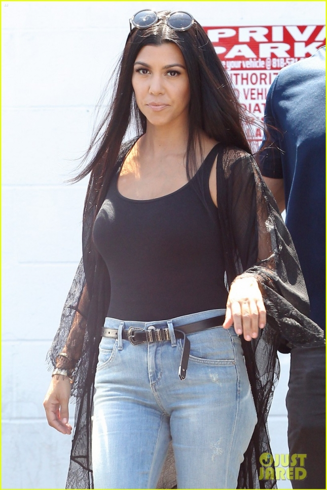 Kourtney Kardashian in Denim Bell Bottoms Exits a Recording Studio