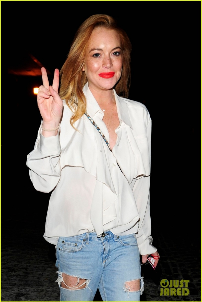 Lindsay Lohan wraps up a peaceful night out at Chiltern Firehouse **USA ONLY**