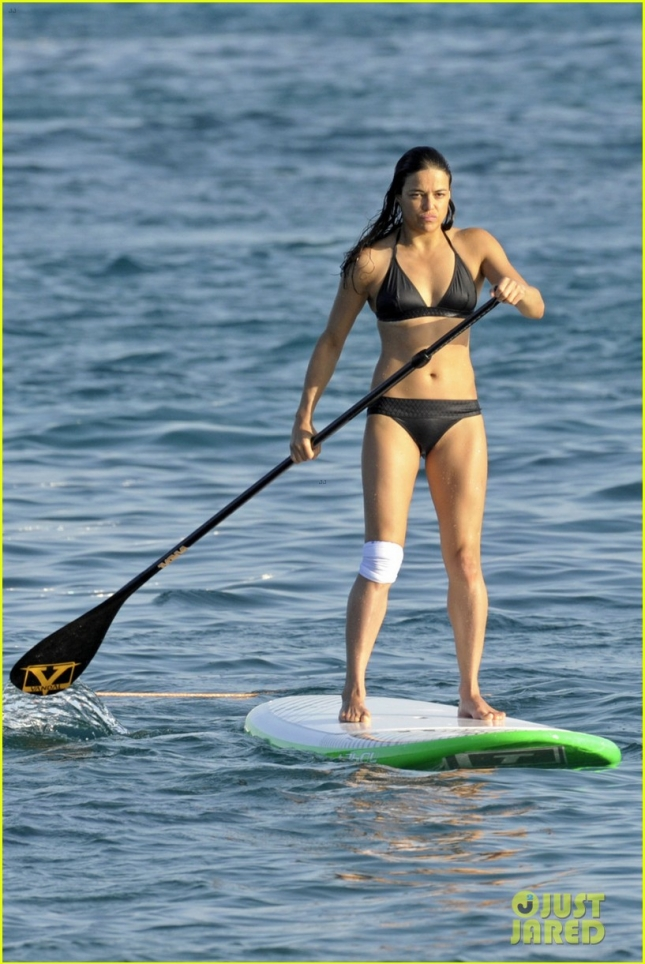 EXCLUSIVE: Michelle Rodriguez spotted in a black bikini paddle boarding during her holiday in Sardinia