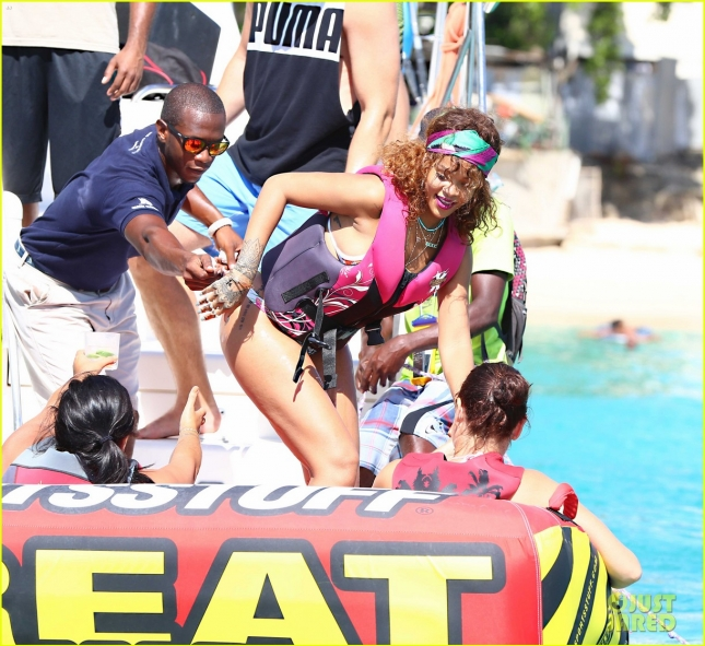 Rihanna and Lewis Hamilton are spotted on a catamaran and doing watersports while on holiday in Barbados