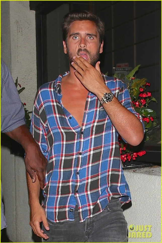 Scott Disick gets a helping hand on his way out of Matsuhisa Restaurant