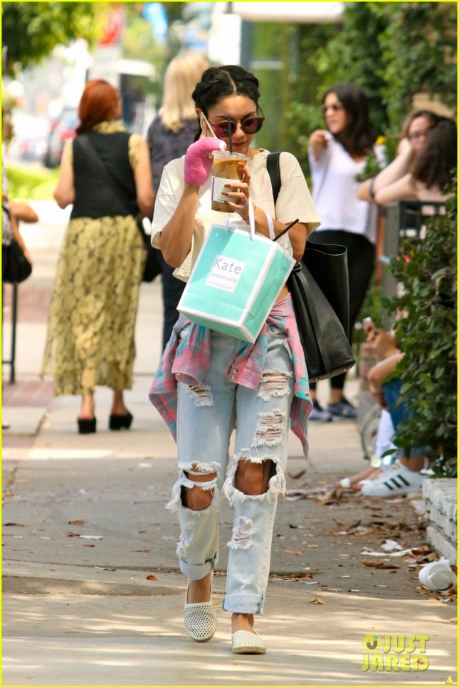 Vanessa Hudgens covers up after a visit to Kate Somerville