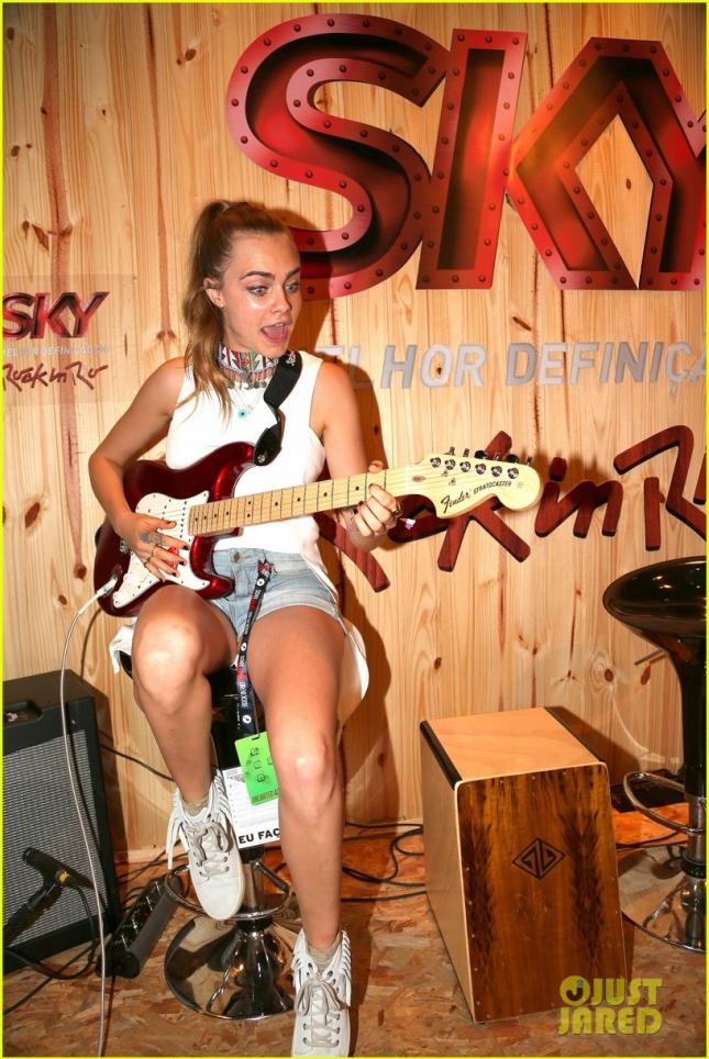 Cara Delevingne gets a custom electric guitar in Rio