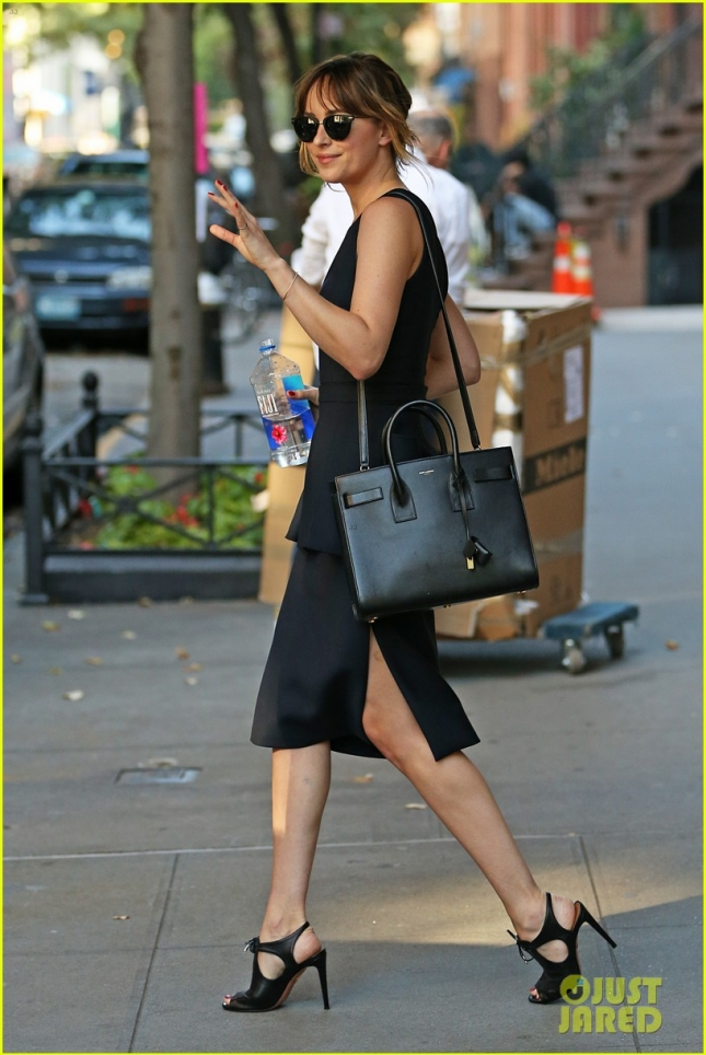 Dakota Johnson heads to Jimmy Fallon wearing a black skirt, NYC