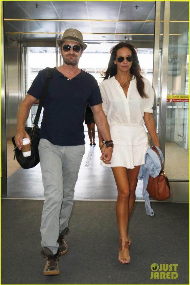 Gerard Butler and girlfriend Morgan Brown seen at Toronto International Airport