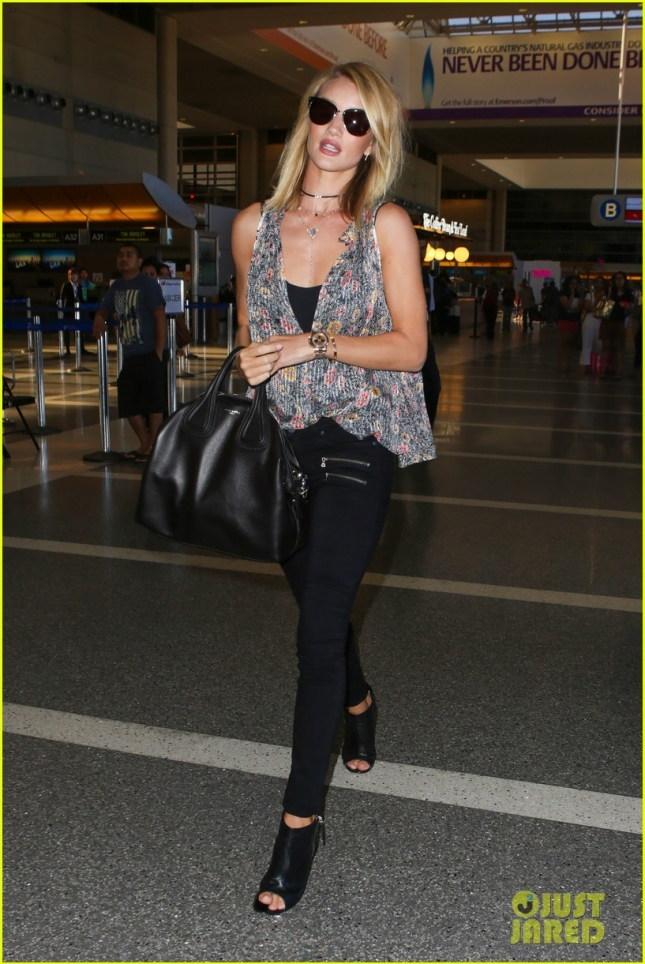 Rosie Huntington-Whiteley turns heads as she departs at LAX **NO UK**