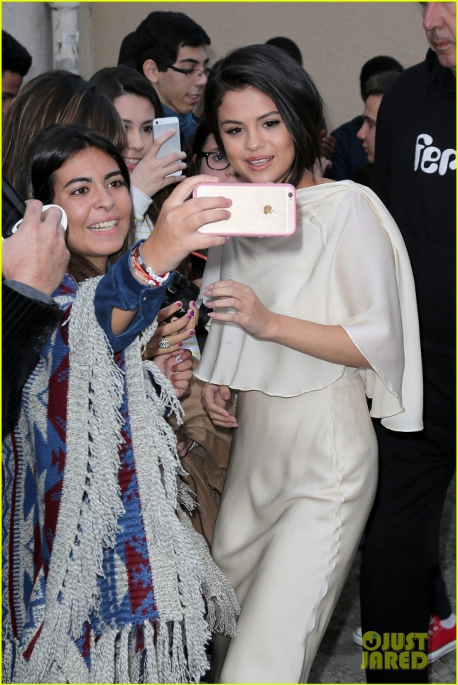 Selena Gomez greets her fans outside the Ferber Studio in Paris **USA, Australia, New Zealand ONLY**