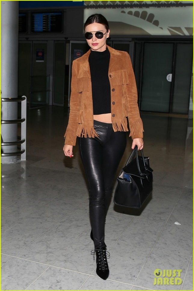 Miranda Kerr is looking lovely in leather as she arrives in Paris  **USA ONLY**