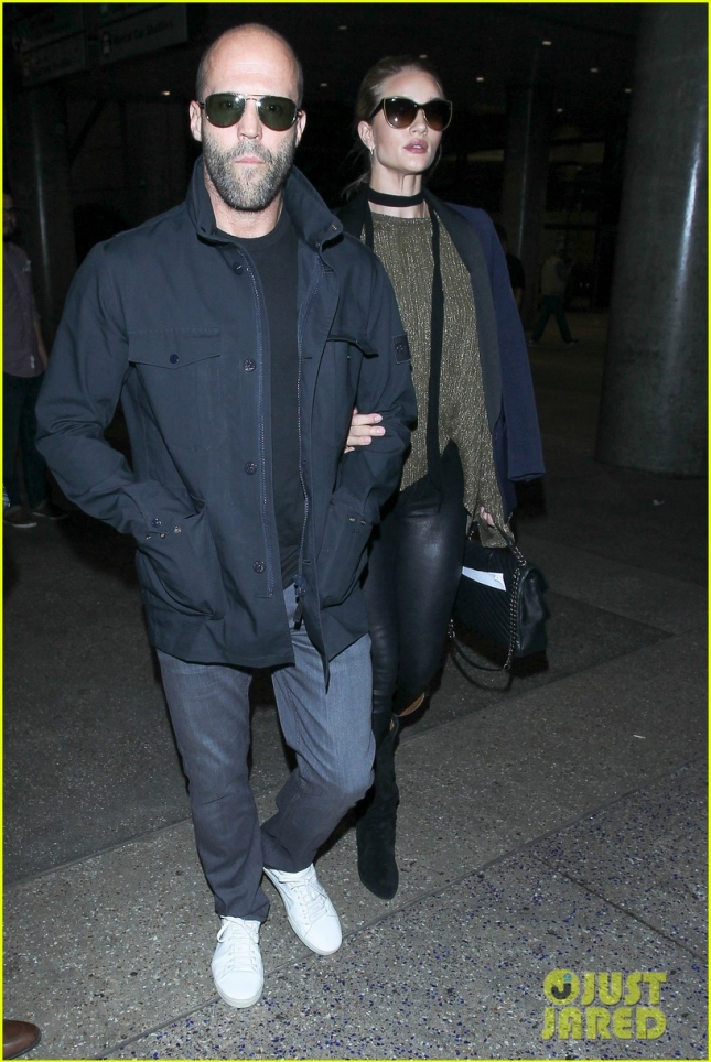 Jason Statham and Rosie Huntington-Whiteley lock arms at LAX