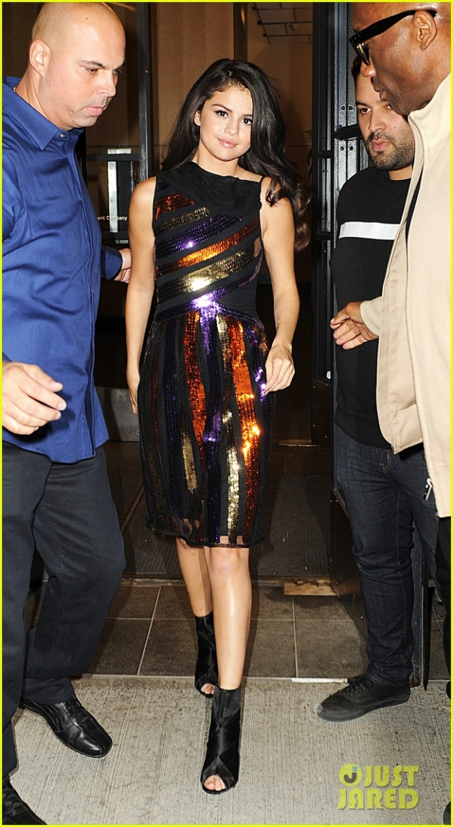 Selena Gomez is all smiles wearing a sparkly rainbow dress as she leaves 'Watch What Happens Live' in NYC