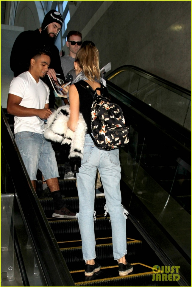 Behati Prinsloo arrives at LAX just a day after walking in VS Fashion show