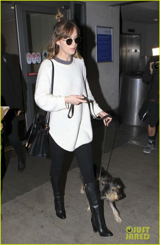 Dakota Johnson looks 50 Shades of exhausted upon arrival at LAX **USA ONLY**