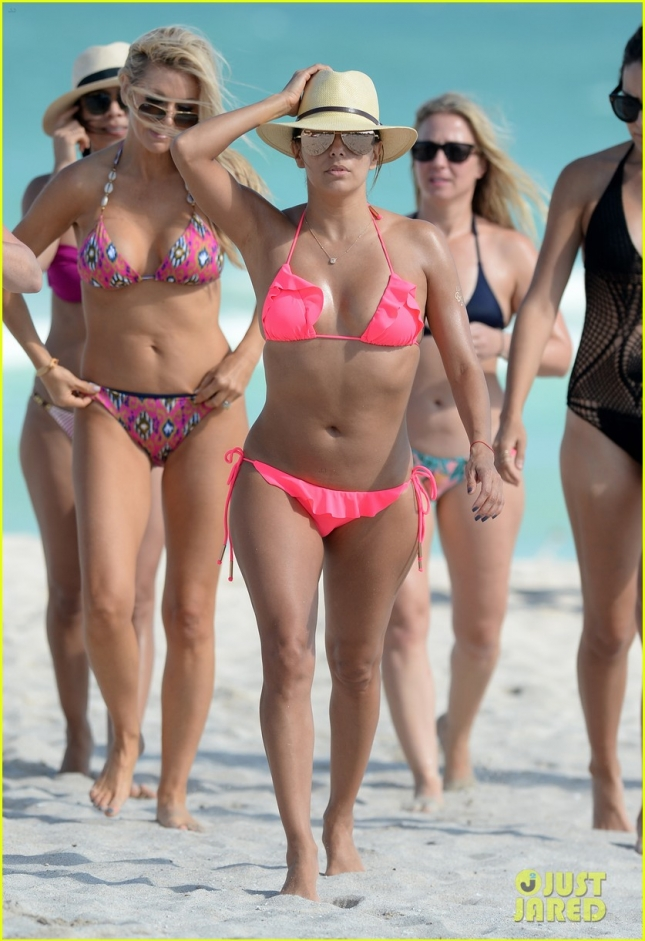Eva Longoria Wears A Hot Pink String Bikini While Relaxing On The Beach With A Group Of Girlfriends In Miami