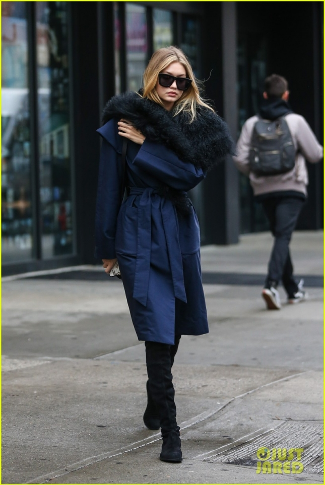 Gigi Hadid bundles up in Big Fur Scarf in NYC