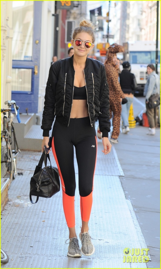 Gigi Hadid looks very sexy rocking a sports bra and bomber jacket in NYC