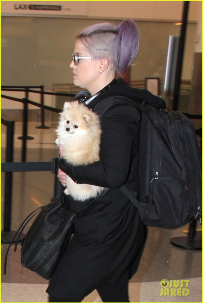 Kelly Osbourne walks with her Dog and Mystery Man at LAX