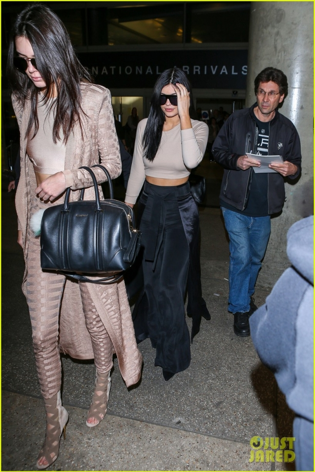 Kendall Jenner and Kylie Jenner look Glam as they land in LA from Oz **USA ONLY**