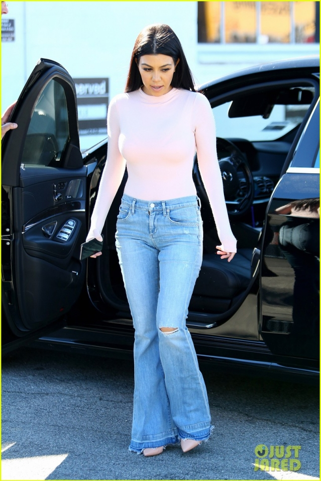 Kourtney Kardashian rocks a Pink Bodysuit with Bell Bottom Jeans