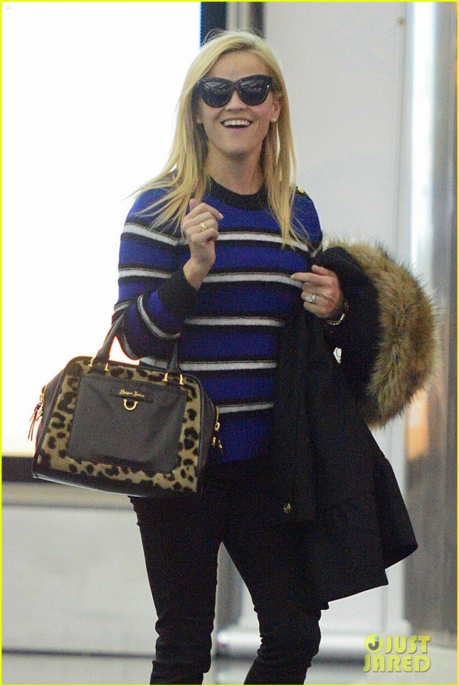 Reese Witherspoon and Jim Toth are happy travelers at JFK **USA ONLY**