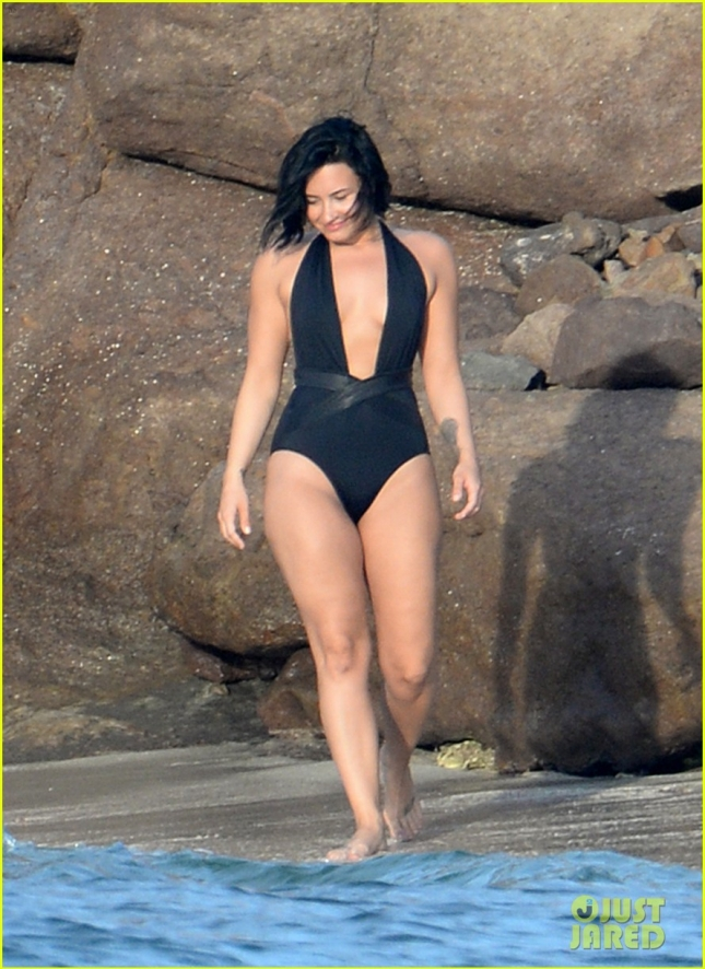 Singer Demi Lovato Wears A Black One-Piece Swimsuit Which She Removes Completely While Swimming In St. Bart's
