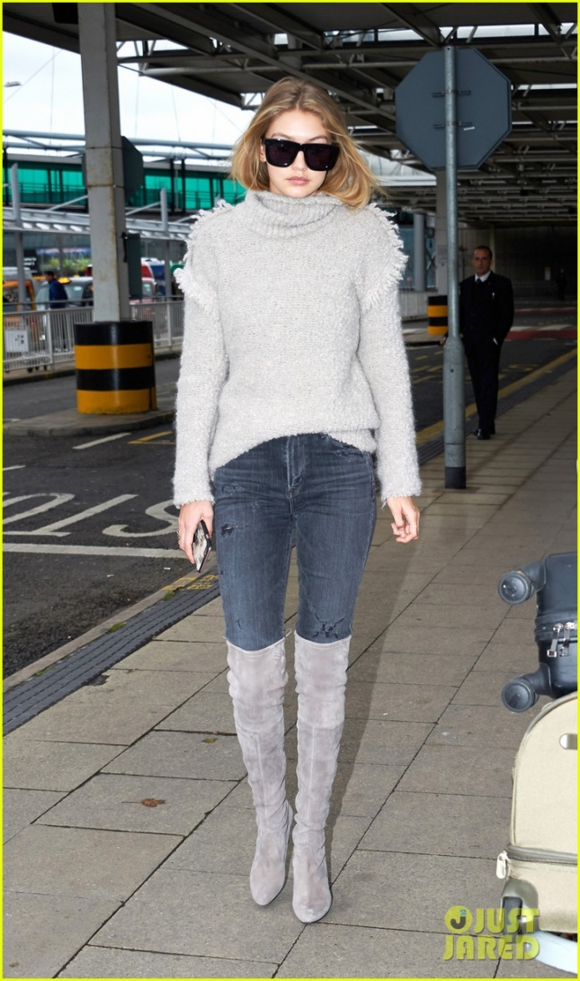 Gigi Hadid flies into Heathrow looking lovely in gray **USA ONLY**