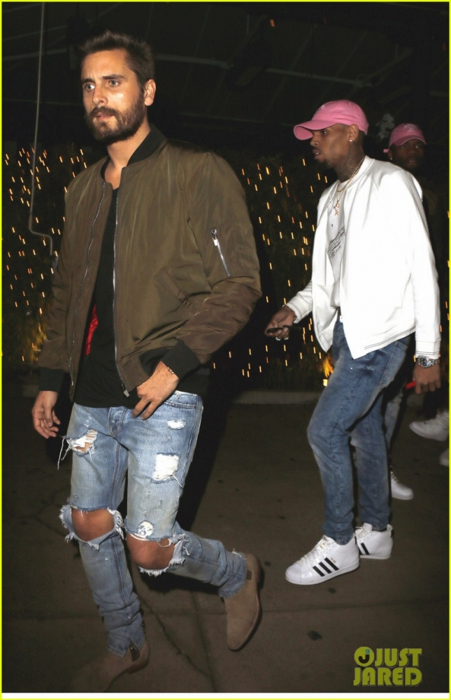 EXCLUSIVE: Scott Disick and Chris Brown seen leaving Koi restaurant in a red Ferrari in West Hollywood