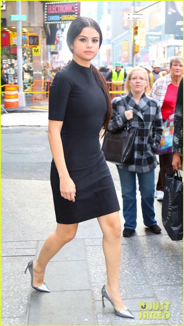 Selena Gomez does impromptu photoshoot in Time Square this afternoon after attending Billboards Women in Music event