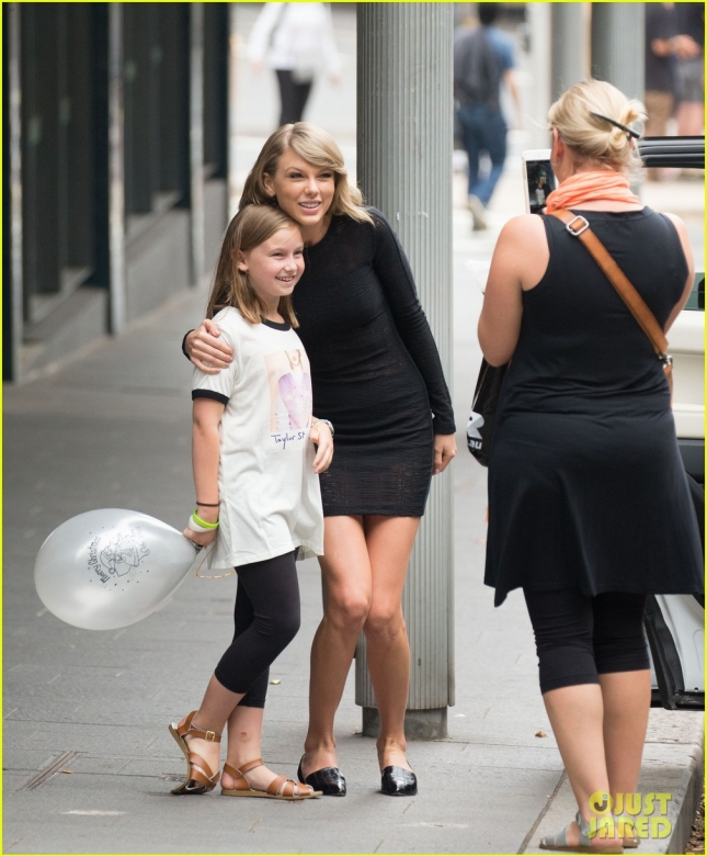 Taylor Swift makes time for a young fan in Sydney **USA and Canada ONLY**