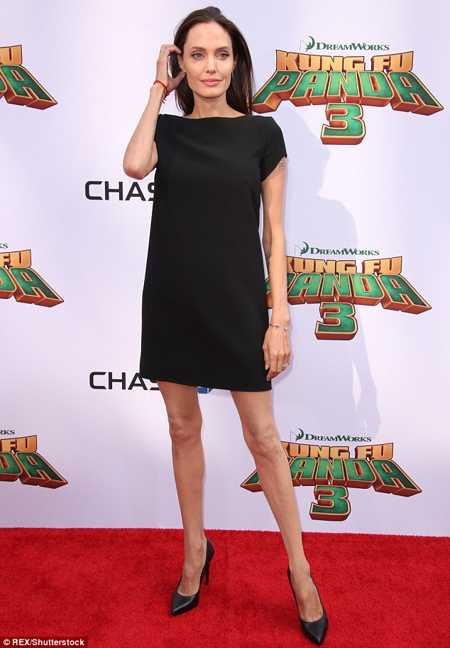 303BE51D00000578-3403084-Angelina_donned_a_black_Saint_Laurent_shift_dress_pairing_the_si-m-46_1452994393782