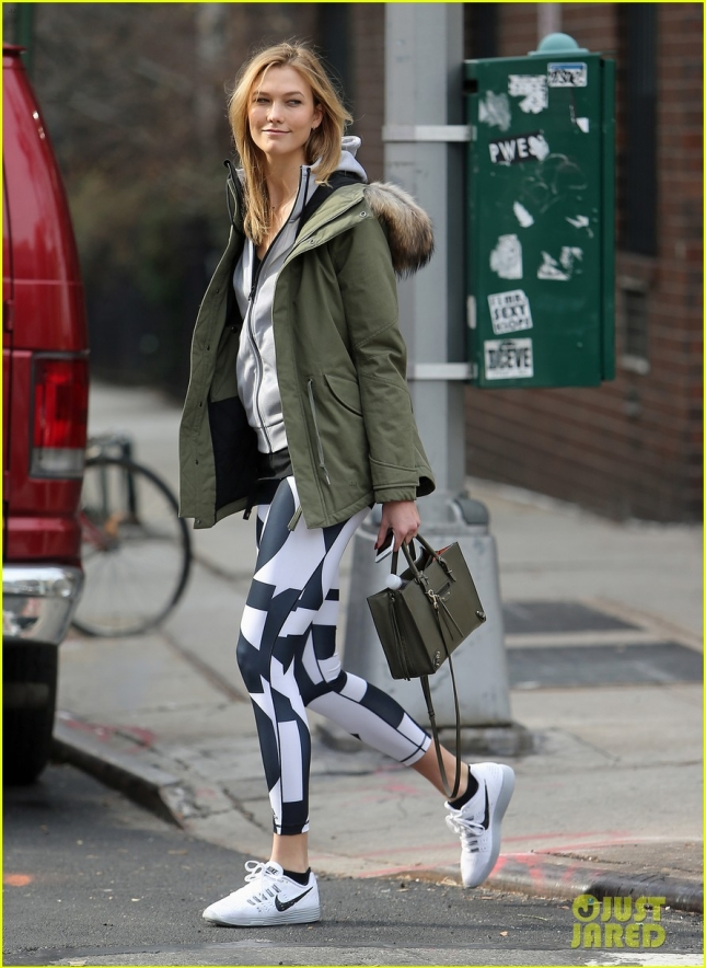 Karlie Kloss steps out of her apartment wearing black and white leggings as she heads to the gym in New York City.