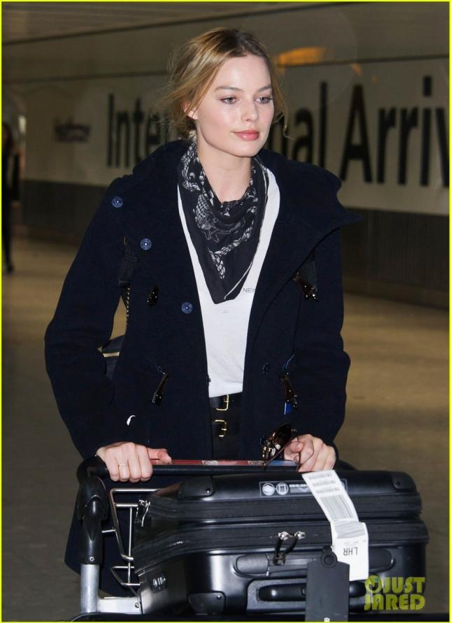 Margot Robbie Arrives On A Flight In London