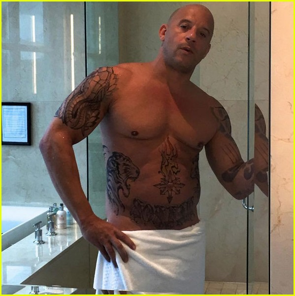 vin-diesel-goes-shirtless-in-a-towel-with-xander-cage-tattoos-01