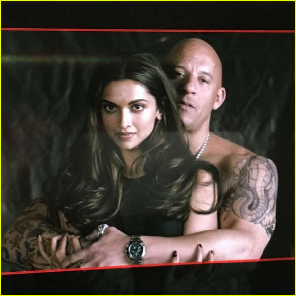 vin-diesel-goes-shirtless-in-a-towel-with-xander-cage-tattoos-02