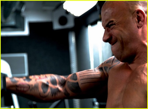 vin-diesel-goes-shirtless-in-a-towel-with-xander-cage-tattoos-04